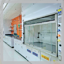 Case Western Reserve University Robbins Research Building: Glass fume hood, drying racks on an orange wall with white cabinets.