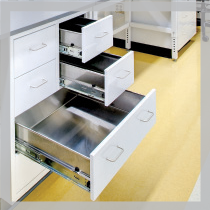 Franklin International Research and Development Lab: White Cabinets with three metal drawers open displaying no snag runners.